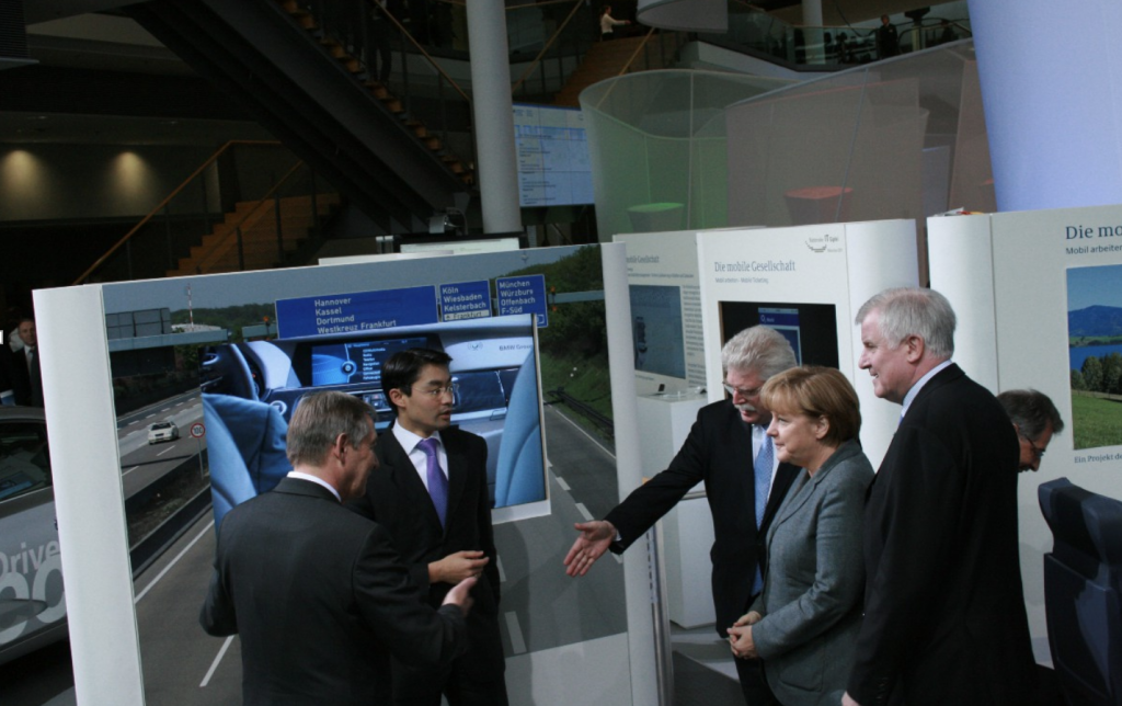 German Chancellor Dr. Angela Merkel with Vice Chancellor and Federal Economics Minister Dr. Philipp Rösler, Bavarian Minister President Horst Seehofer, Bavarian Economics Minister Martin Zeil, and Siemens' Head of R&D Dr.-Ing. Reinhold Achatz at the booth of the Mobile Society during the 2011 IT Summit in Munich, Germany.